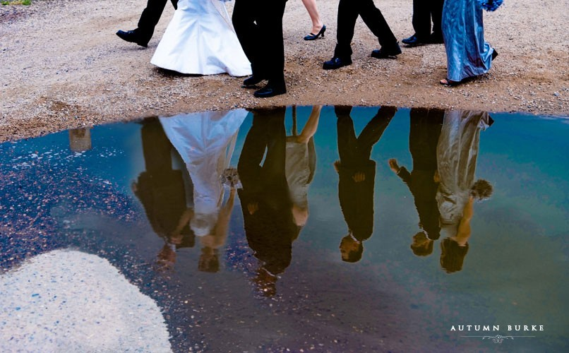 wedding party reflection in puddle