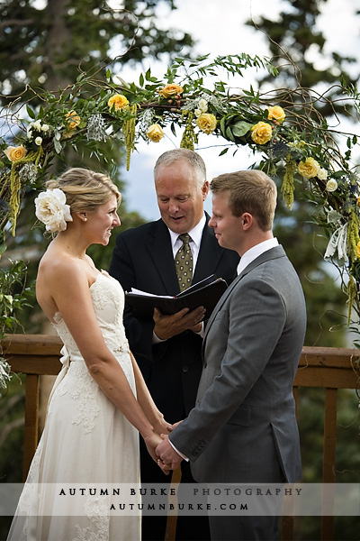 colorado mountain wedding ceremony floral arch