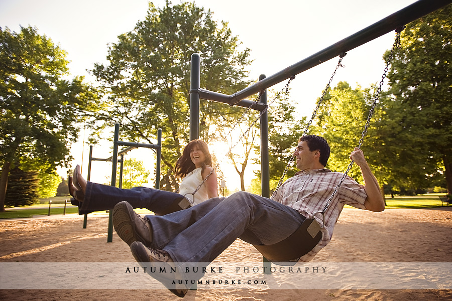 denver colorado city park engagement portrait session playground swings