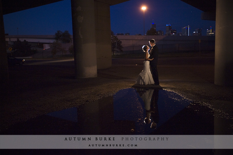 denver colorado mile high station wedding at night reflection puddle city lights