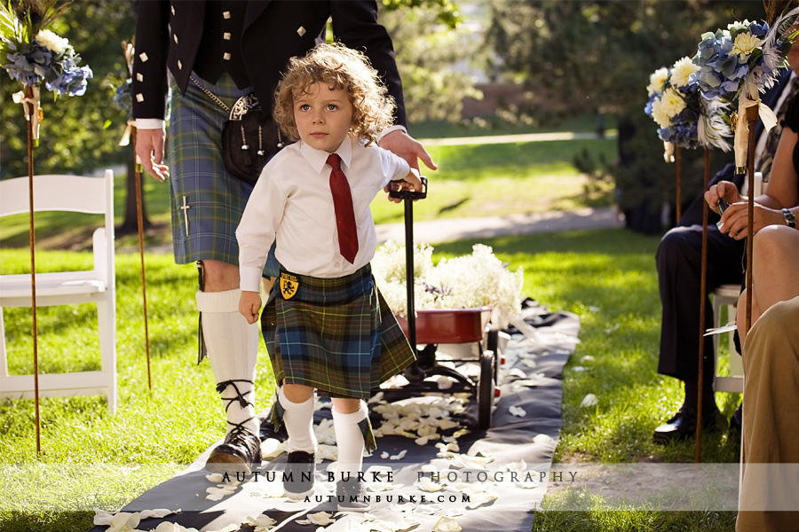 colorado wedding ceremony ring bearer in kilt pulling wagon