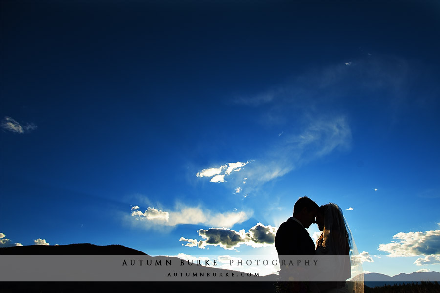 colorado bluebird sky bride groom silhouette keystone mountain wedding