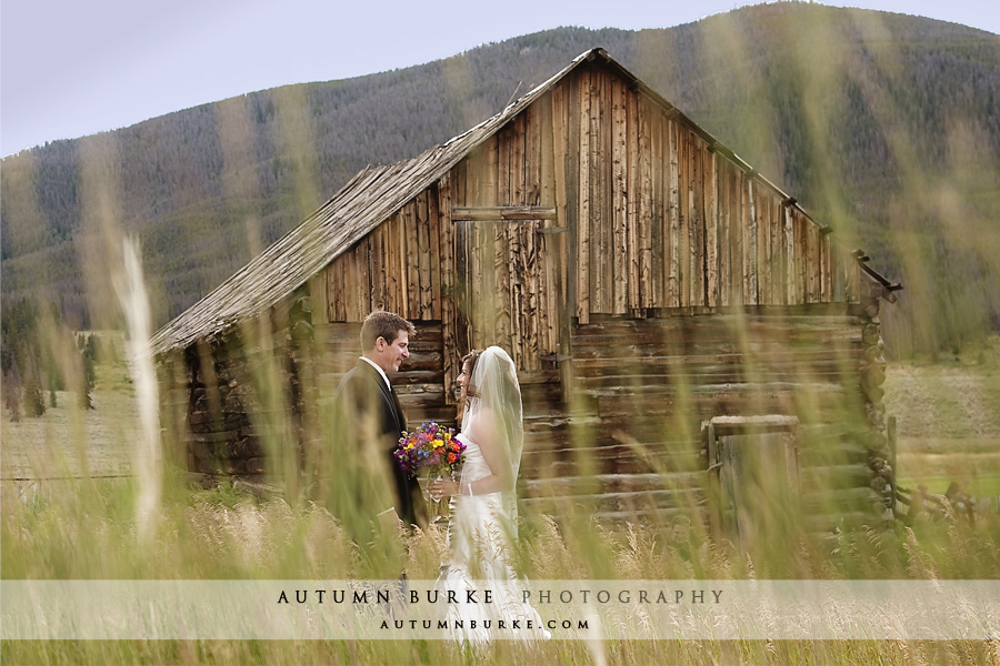 keystone ranch mountain wedding old cabins bride groom first look