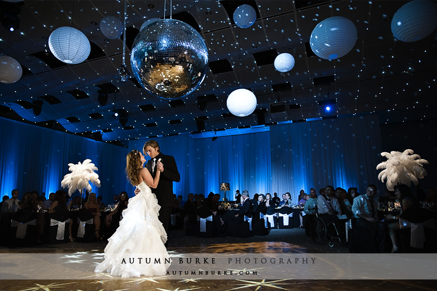 seawell ballroom denver wedding first dance blue decor feathers lighting
