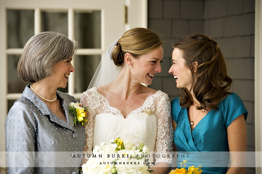 denver country club winter wedding bride laughing with sister bridesmaid and mom