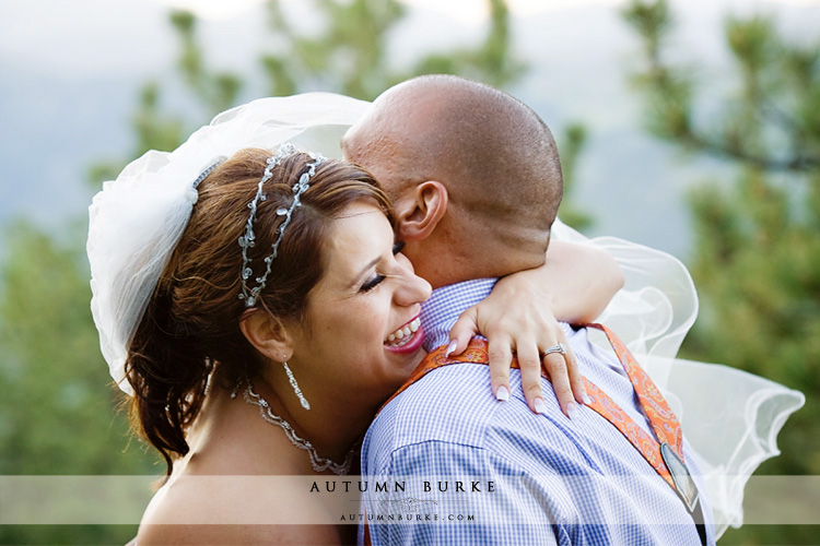 joy laughter bride and groom embrace colorado wedding mt vernon
