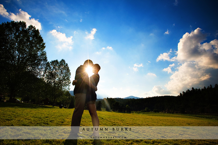 colorado bluebird sky silhouette sun lake evergreen mountain engagement
