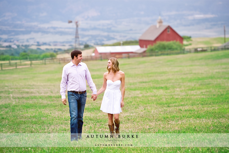colorado farm wedding engagement session fields and barn and cowboy boots