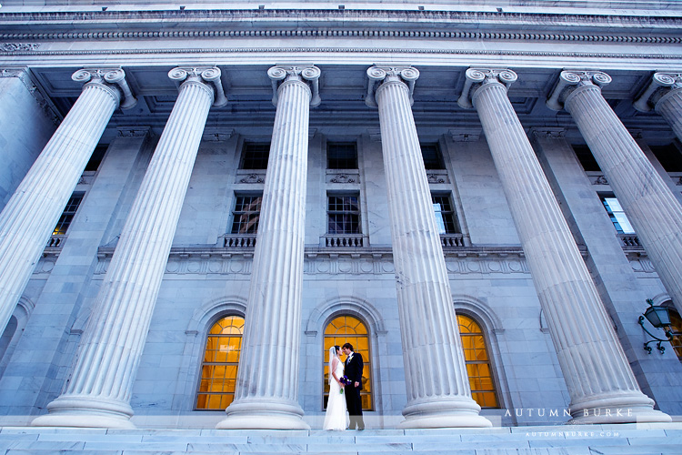 downtown denver urban colorado wedding portraits bride groom historic building columns