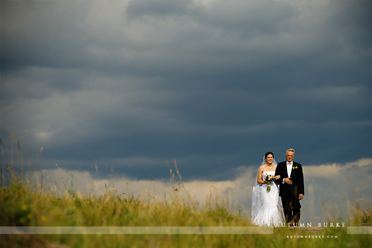 vail wedding deck ceremony father walking bride down the aisle dramatic sky