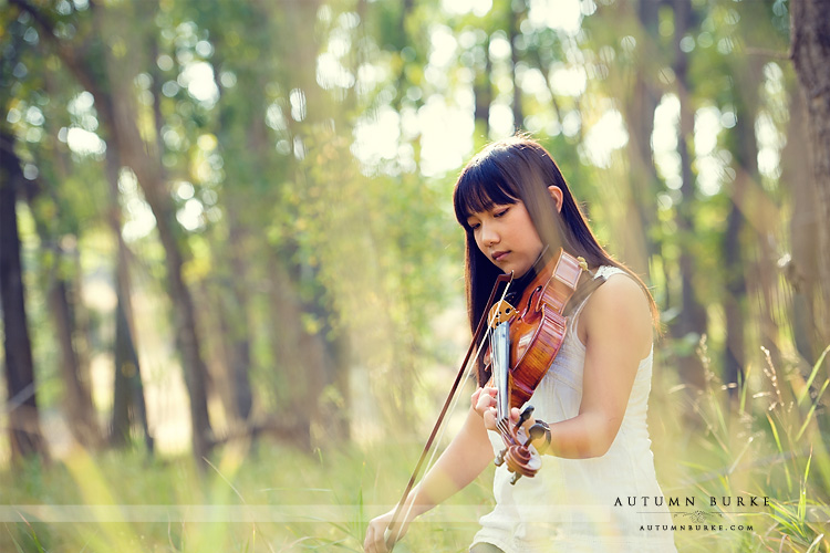 colorado senior portrait outdoors rustic with viola violin instrument