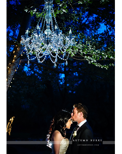 denver colorado lionsgate event center wedding bride and groom outdoor chandelier