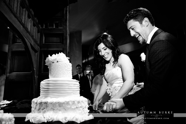 lionsgate wedding colorado bride and groom cutting cake
