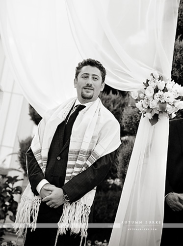 groom waits for bride under the chuppah at lionsgate event center colorado wedding