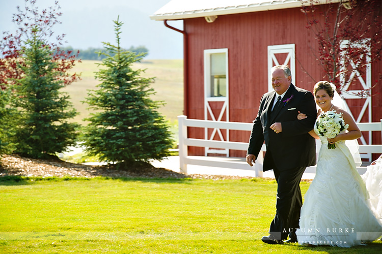crooked willow wedding ceremony colorado barn father walking bride down the aisle