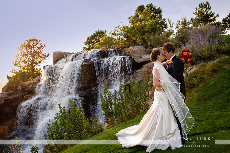 the sanctuary golf course sedalia colorado wedding bride and groom waterfall