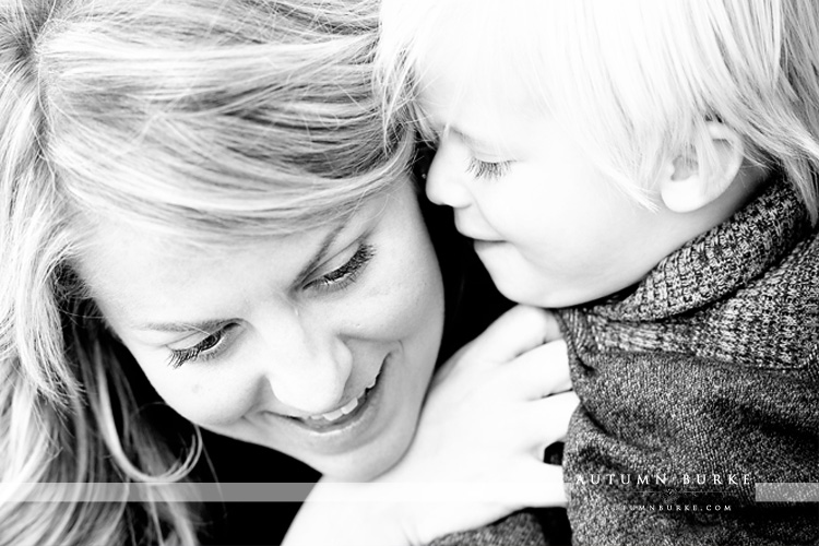 baby whispering to mom black and white portrait denver colorado family portrait