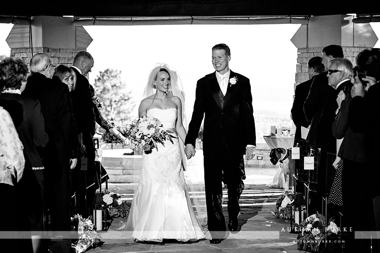 sanctuary colorado wedding ceremony sedlia classic bride and groom walk down the aisle