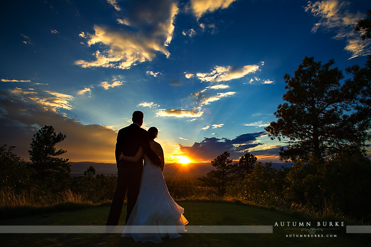 the sanctuary sedalia colorado incredible sunset with bride and groom