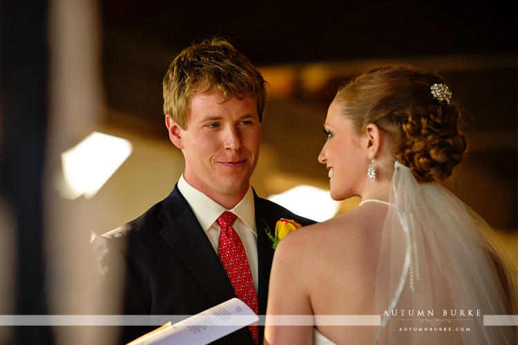 groom gazes at bride during colorado wedding ceremony at the sanctuary golf club sedalia