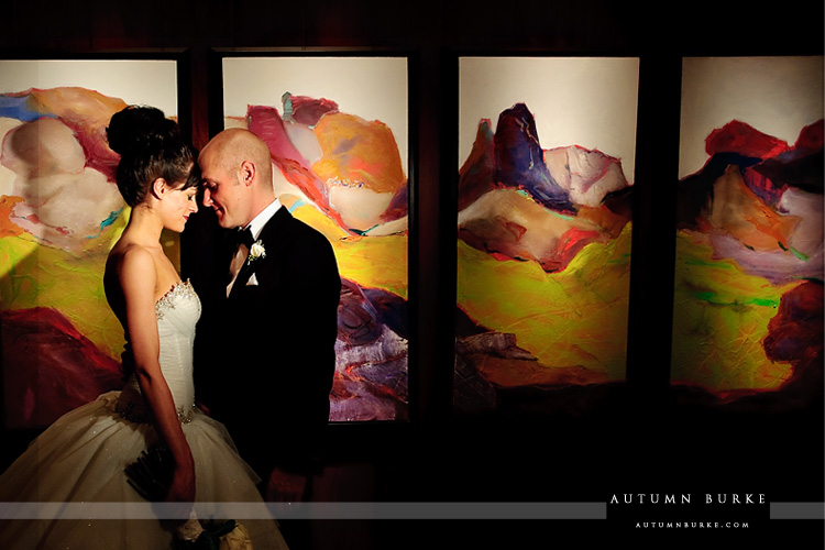 bride and groom in front of the art at the four seasons vail colorado