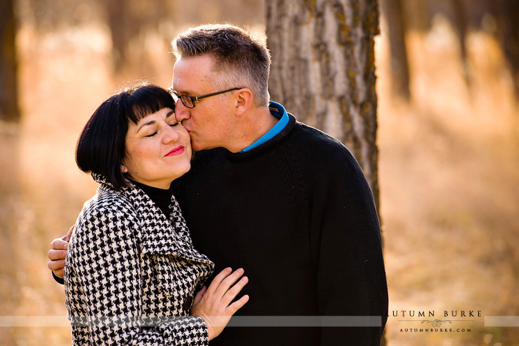 denver wedding engagement portrait couple kissing sweet
