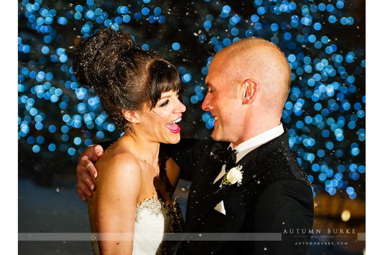 four seasons vail colorado winter wedding bride and groom laughter snow