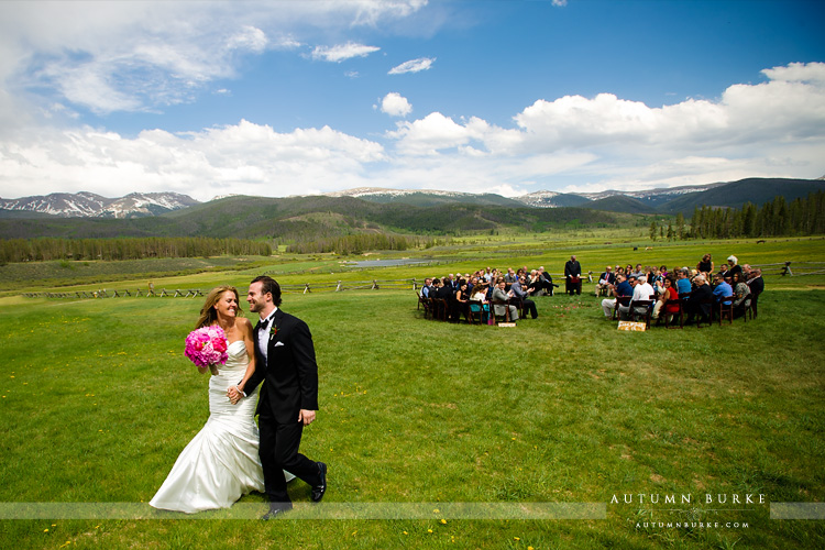 bride and groom exit wedding ceremony devils thumb ranch colorado mountains