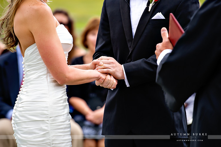 devils thumb ranch colorado wedding ceremony hands entwined
