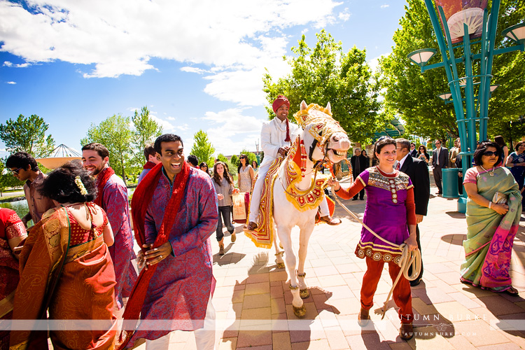 colorado indian wedding grooms processional white horse