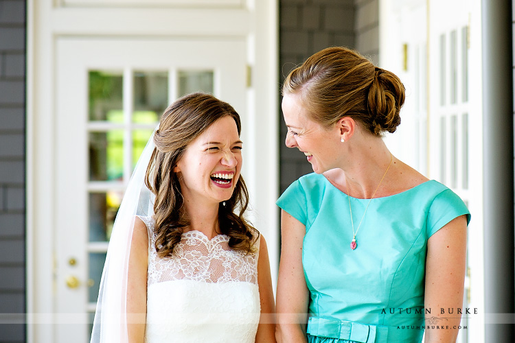 denver country club colorado wedding bride portrait with sister laughter joy emotion