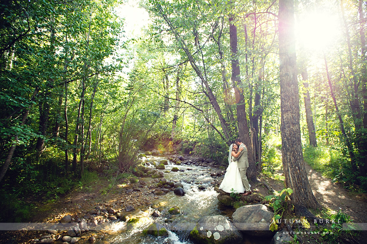 beaver creek allies cabin wedding chapel ceremony bride and groom by river