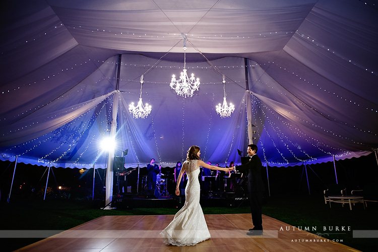 tent with chandeliers first dance at denver country club wedding colorado