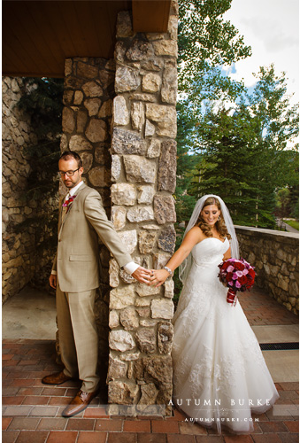 bride and groom first touch beaver creek allies cabin wedding