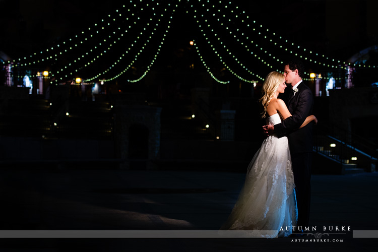 colorado mountain wedding vail arrabelle courtyard night lights bride and groom