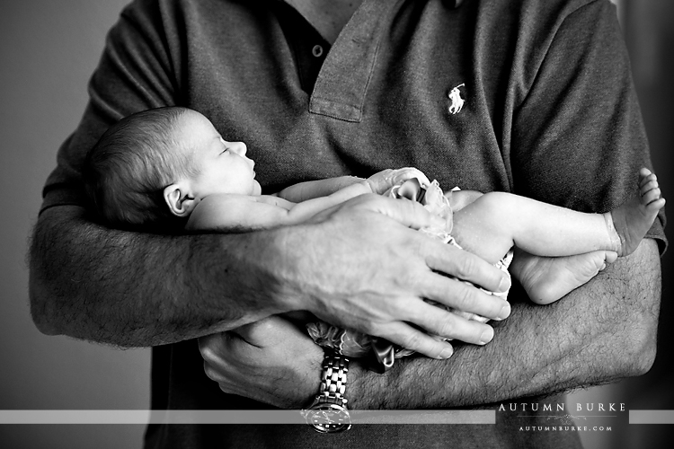 denver family portrait newborn baby cradled in daddy's arms colorado