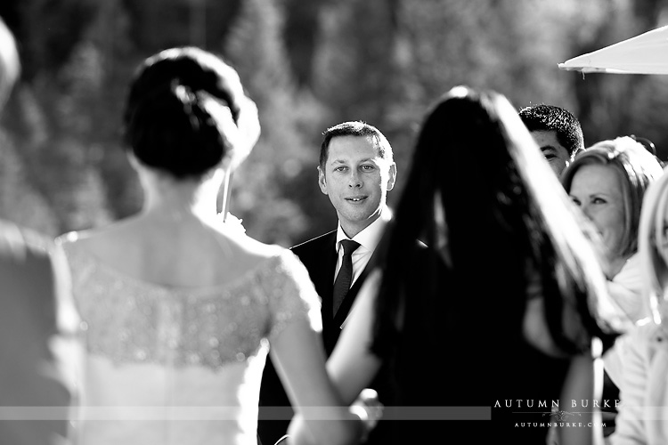 four seasons vail wedding ceremony colorado groom sees bride