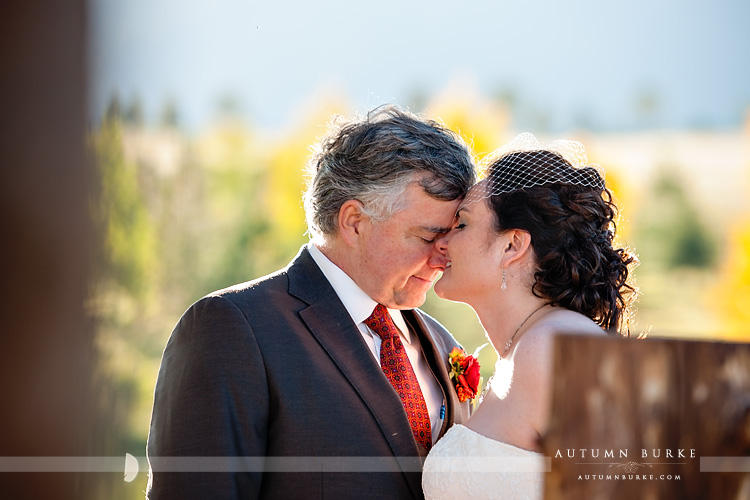 spruce mountain ranch larkspur colorado outdoor autumn fall wedding emotion moment love bride and groom