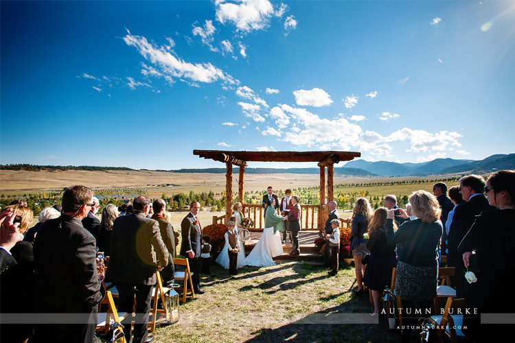spruce mountain ranch wedding ceremony larkspur colorado mountain backdrop