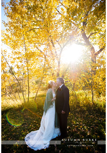 spruce mountain ranch sunkissed bride and groom colorado rustic wedding revel and bloom