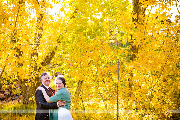 fall wedding spruce mountain ranch aspen bride and groom portrait laughter