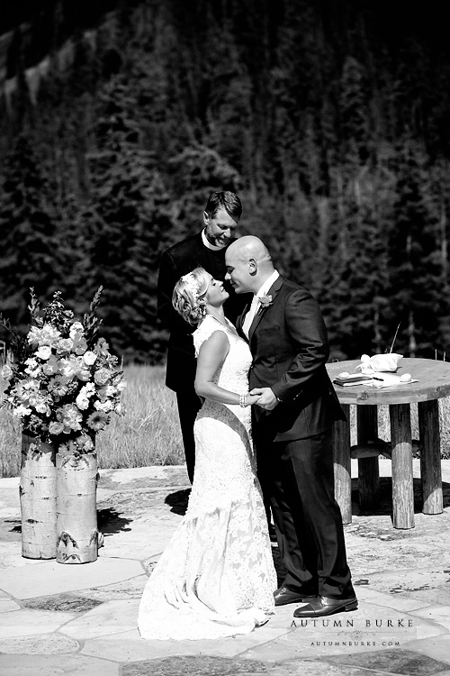 beautiful colorado mountain wedding beaver creek wedding deck ceremony kiss