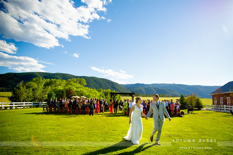 colorado wedding ceremony crooked willow farms barn just married bride and groom