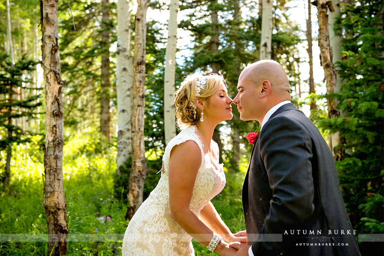 colordao mountain wedding beaver creek bride and groom in aspen trees