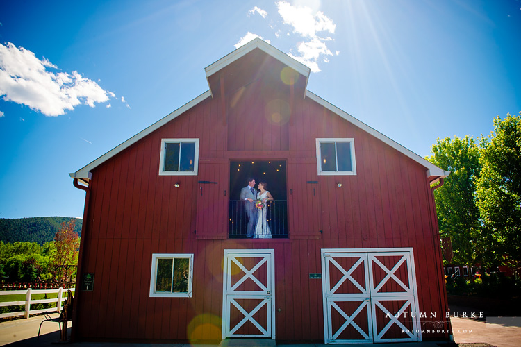 crooked willow farms wedding bride and groom in barn larkspur colorado
