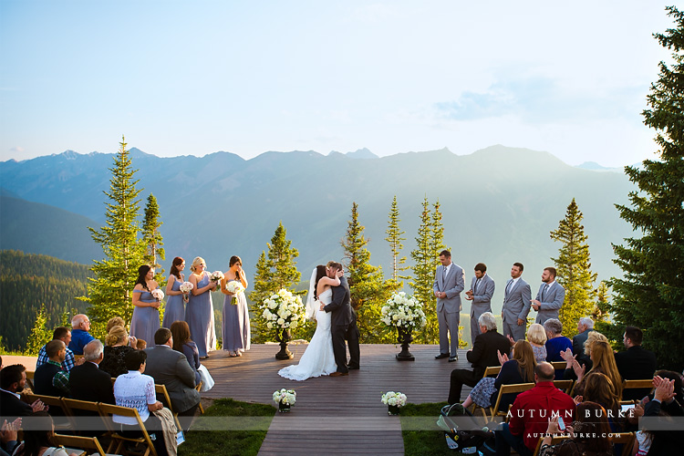 aspen wedding deck ceremony colorado mountain wedding bride and groom just married wedding little nell