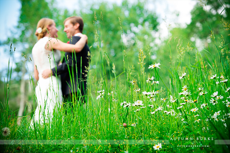 beaver creek saddle ridge wedding colorado mountain wedding bride and groom field wildflowers