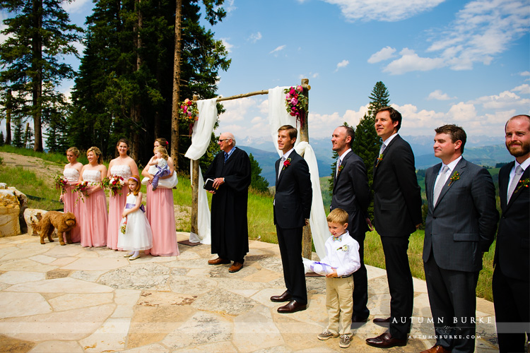 beaver creek wedding deck colorado mountain ceremony groom watches bride walk down aisle