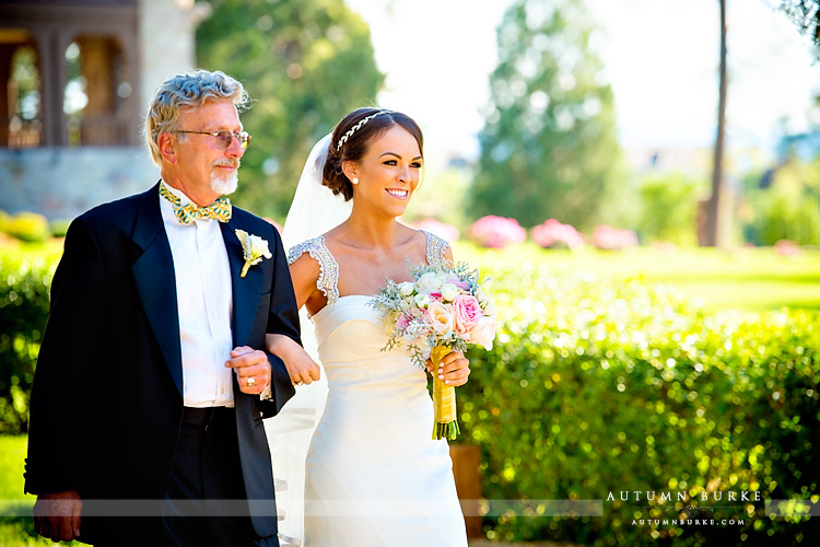 colorado highlands ranch mansion wedding ceremony dad walks bride down aisle