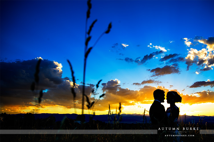 colorado highlands ranch mansion wedding sunset silhouette